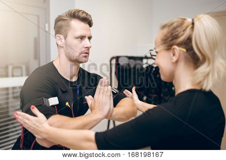 Concentrated Sportsman In Yoga Pose Training With Coach