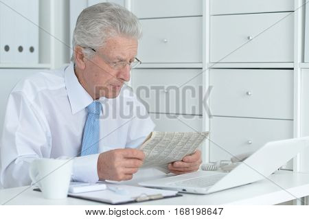 Portrait of a handsome senior businessman working at office