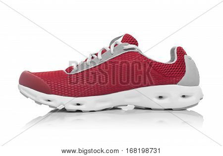Unbranded modern sneaker isolated on a white background. Red sneaker.