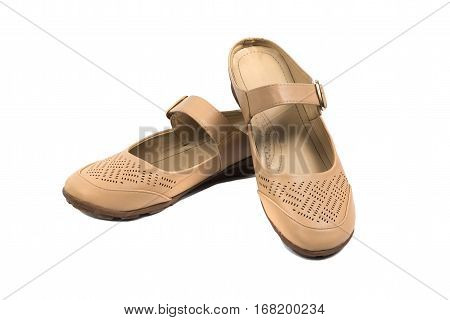 Suede women shoes beige sandal with belts isolated with soft shadow on white background.