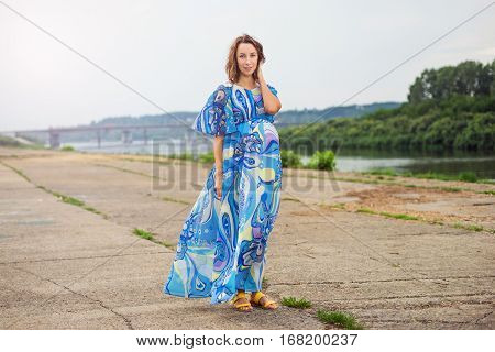 Pregnant Woman Walking Along The Promenade