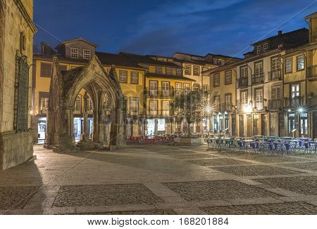 Oliveira square with church and Padrao do Salado monument at the dusk, Guimaraes - Portugal