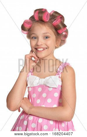 cute little girl with curlers on her head