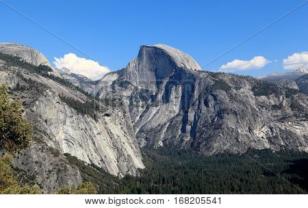 In view are North Dome, Half Dome, and Yosemite Valley. Photographed looking east from the Upper Yosemite Fall Trail, Yosemite National Park, California.