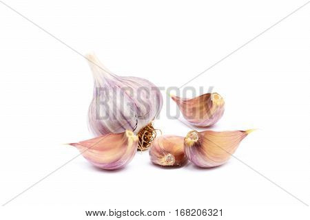 Healthy fresh garlic cloves isolated on white background