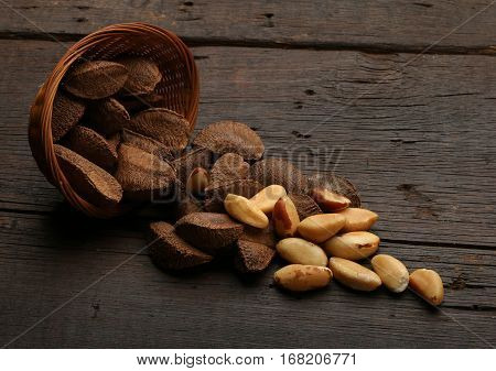 Group of brazil nuts in a bowl over a wooden background