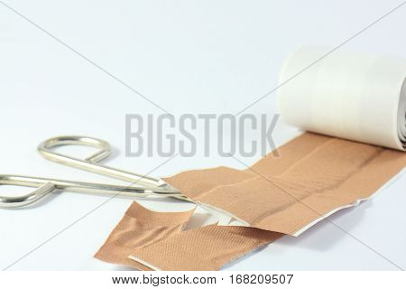 The iron scissors and a patch on a white background