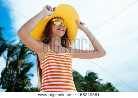 10 years old child girl relaxing on the beach on tropical island.