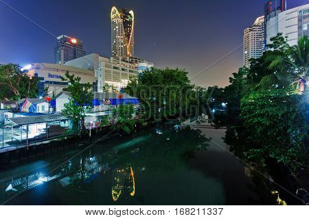 BANGKOK, THAILAND - NOVEMBER 25, 2009:  Bangkok canal night view in the business  and shopping  district near Central World and Siam Paragon are the most famous shopping malls.