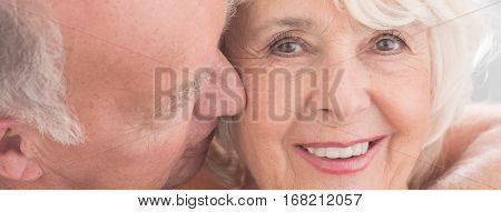 Elderly Husband Kissing His Happy Wife