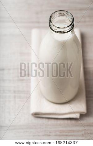 Kefir in a glass bottle on the napkin vertical