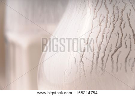 Glass and pitcher of kefir close-up horizontal
