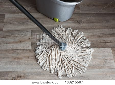 Wash your wooden floors with a wet cloth
