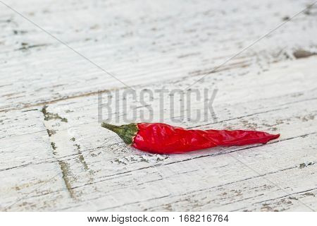 cayenne pepper on an old white wooden table