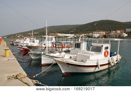 AGISTRI, GREECE - MAY 12, 2016: Small boats moored at Milos harbour on the Greek island of Agistri. Just under an hour from Piraeus, the island is a popular destination for Athenians.