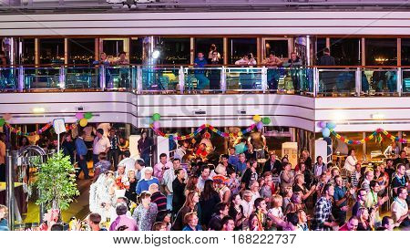 People On Dancing Party On Deck Of Cruise Liner