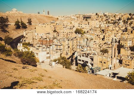 Photo of the Amman city view with Umayyad Palace on background. Urban landscape. Residential area. Arabic architecture. Eastern city