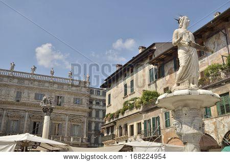 VERONA, ITALY - AUGUST 6, 2014: Statue of Madonna at Market square in Verona Veneto Italy