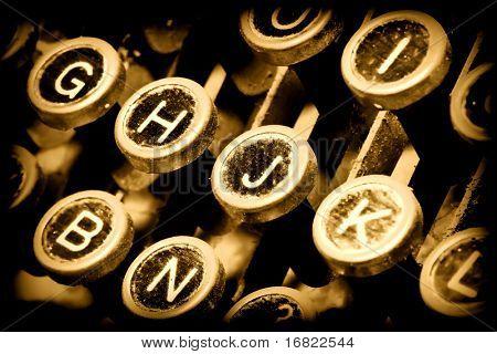 detail of golden typewriter, close up on keys