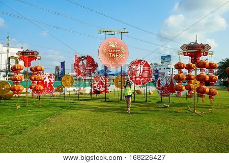 PATTAYA, THAILAND - CIRCA FEBRUARY, 2016: woman posing with Chinese New Year decorations. The Chinese New Year is the most important holiday for ethnic Chinese people all around the world.