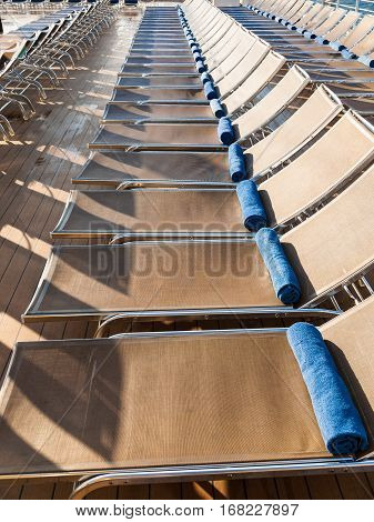 empty chairs in outdoor relaxation area on stern of cruise liner