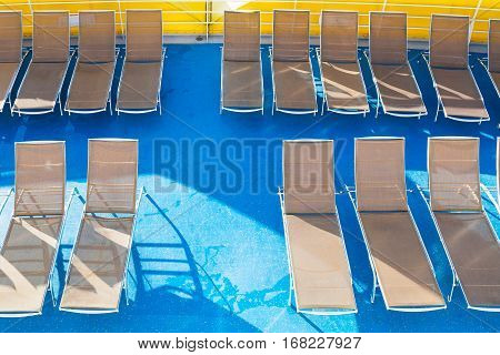 top view of empty chairs in sunbathing area on stern of cruise liner