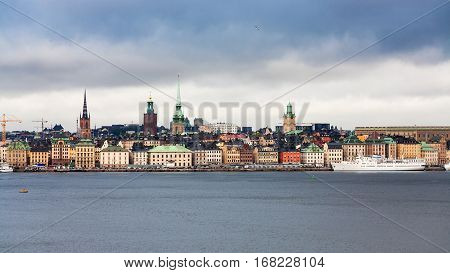 panoramic view of center of Stockholm city (Galma Stan) from sea in cloudy autumn day