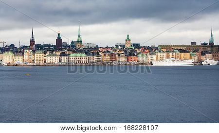 panorama of Stockholm city (Galma Stan) from sea in cloudy autumn day