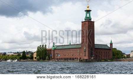 view of Town Hall in Stockholm city from water in autumn day