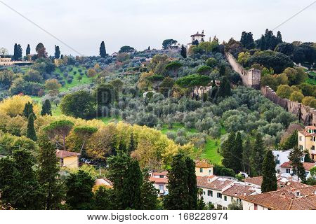 travel to Italy - above view of gardens and wall of Giardino Bardini from Piazzale Michelangelo in Florence city in autumn evening