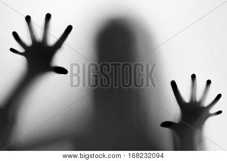 Strange and mysterious woman with twelve fingers behind the window