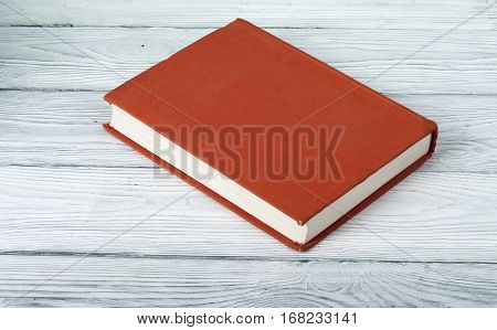 Red book on wooden table.Education background.Back to school.