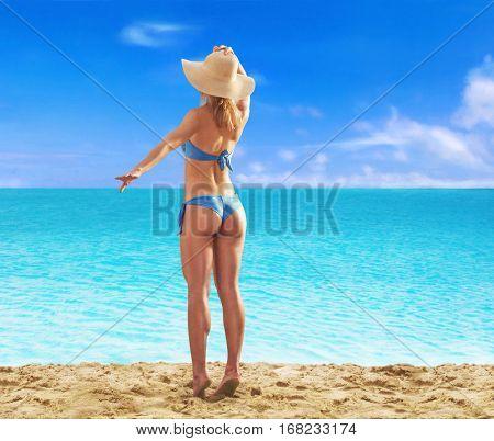 Feeling the sun at beautiful beach. sunbathing fitness woman looking the sea waiting the boat.