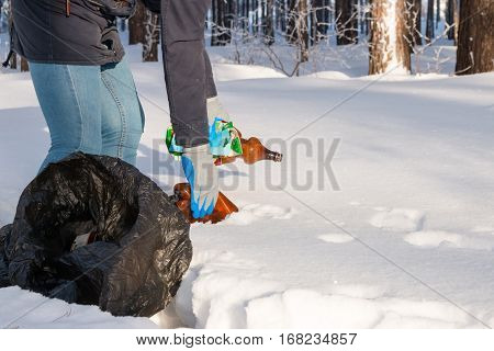 Girl Collects The Garbage In The Forest