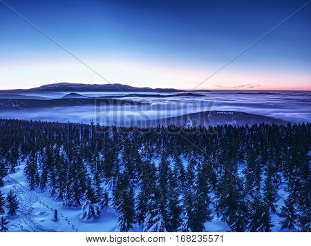 Highest Hills Above Inverse Mist. Winter Cold Weather In Mountains