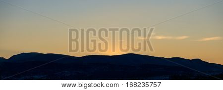 Beautiful background of sunset over mountains