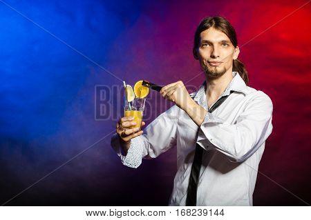 Bartender With Orange Drink.