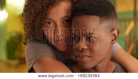 Close-up Portrait Of African American Man And Woman Embracing Each Other On A Night On The Town