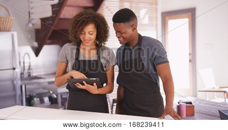 Black Man And Woman Plan Their Recipe On Their Tablet