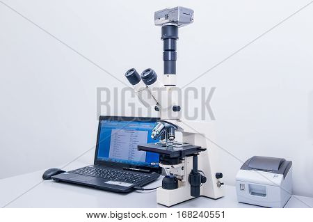 Modern Microscope Equipped With Digital Camera And Computer In Clinic Laboratory. Selective Focus