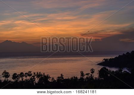 The rising sun from the mountain, Amed,  Bali Indonesia (Sunrice on the sea)