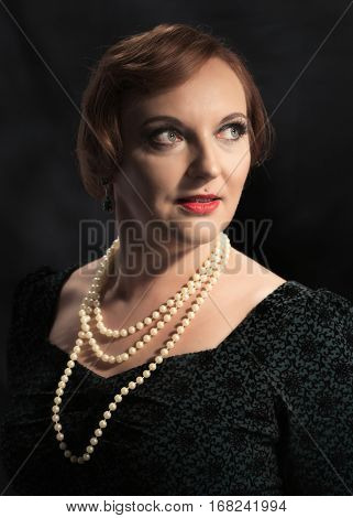 Twenties style classic portrait of woman wearing a pearl necklace