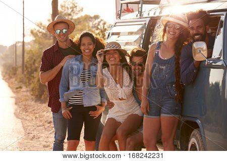 Friends travelling in a camper van make a roadside stop