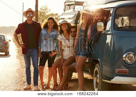 Friends in a camper van make a roadside stop, full length