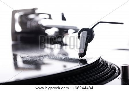 DJ headshell on spinning record close up