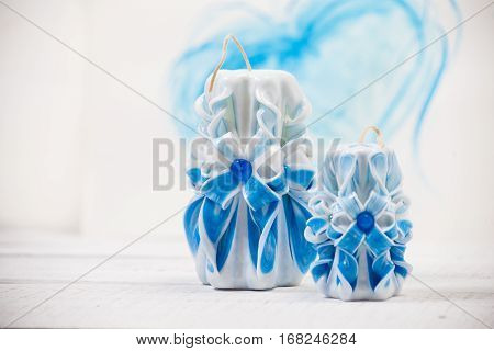 St. Valentine's Day: two carved candles of blue color against the background of blue heart. Symbol.