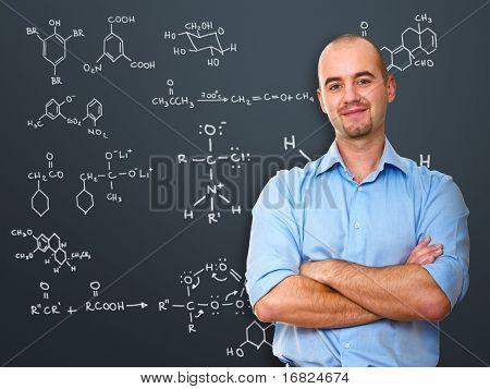 portrait of white teacher infront of blackboard