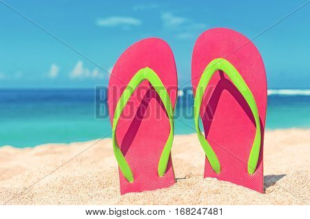 Beautiful beach. Beach sandals on the sandy coast. Summer holiday and vacation concept.