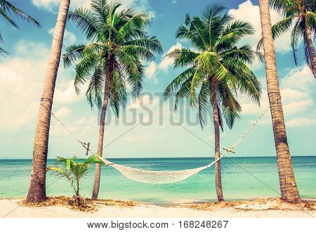 Beautiful beach. View of nice tropical beach with palms around. Holiday and vacation concept. Beautiful tropical island in Thailand.
