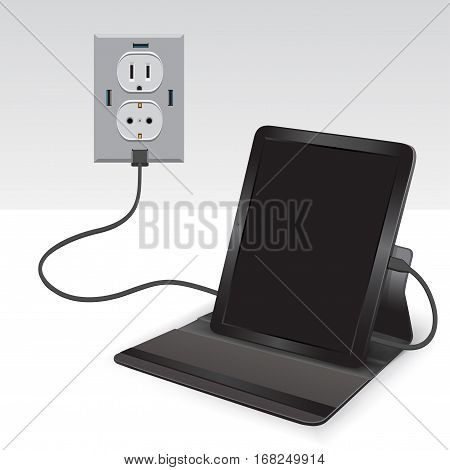 Black tablet charging from usb outlet on light background. Mobile phone charge